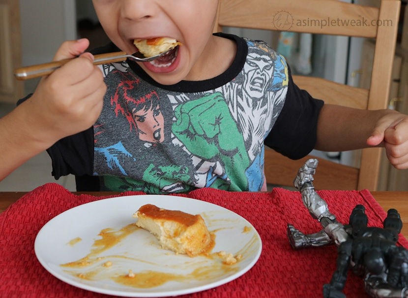 child eating flan