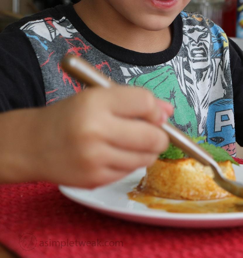 kid eating Spanish flan