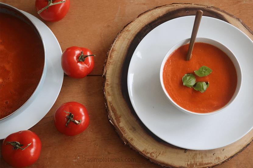 A bowl and pot of Homemade Creamy Tomato Soup