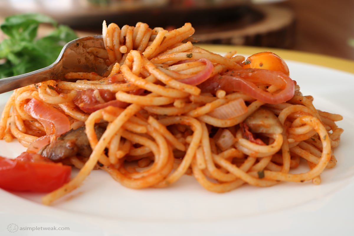 a white plate and fork with Spaghetti with Fire Roasted Crushed Tomato Sauce 3