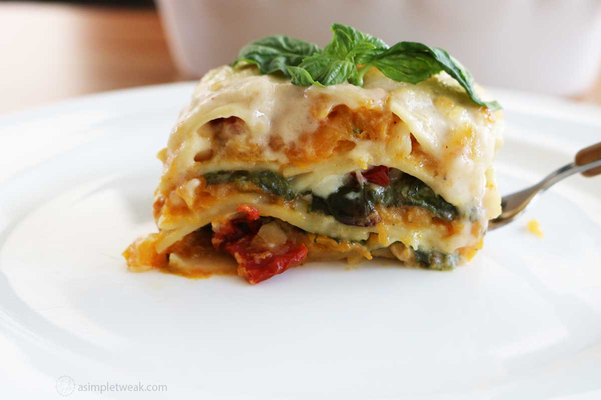 A-slice-of-butternut-squash-lasagna-on-a-white-plate