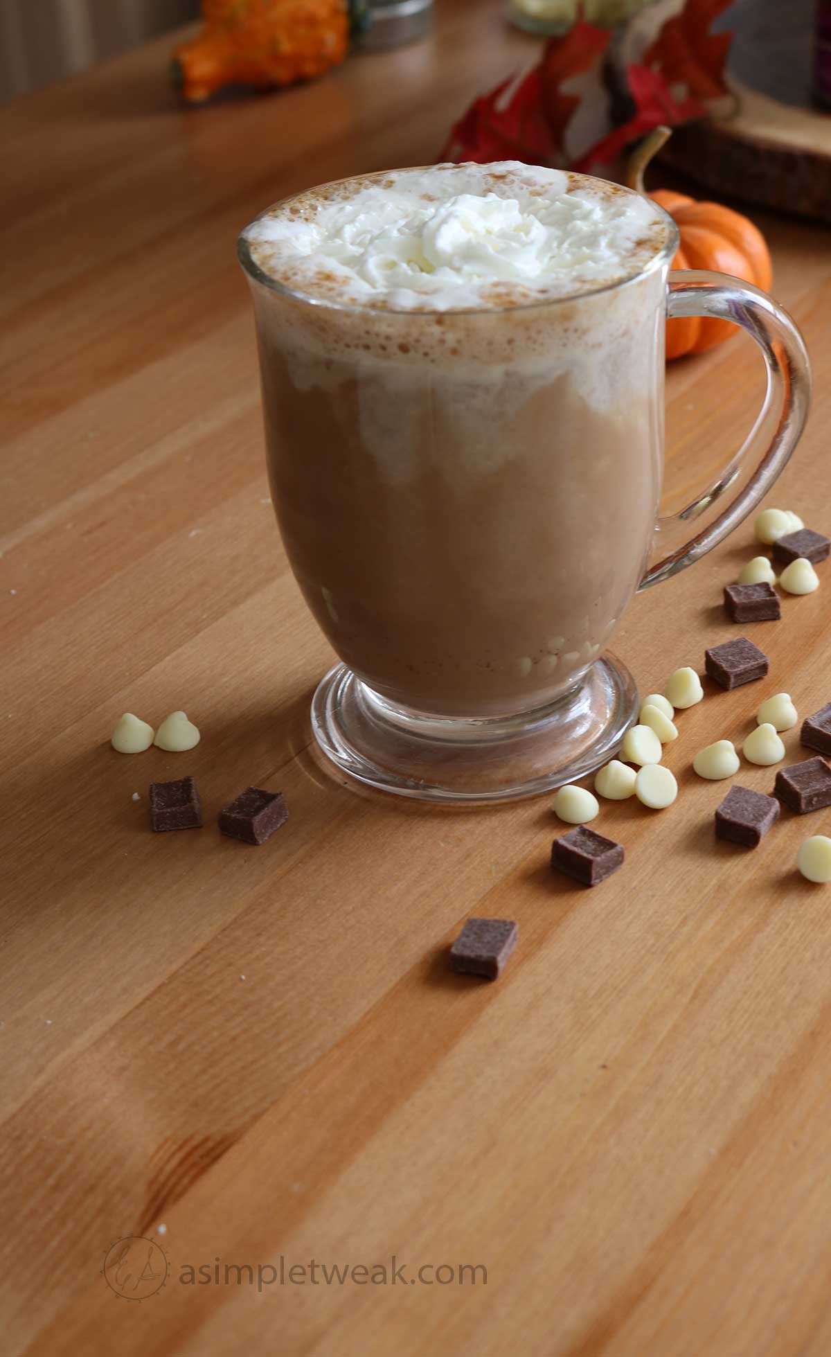a clear glass cup with pumpkin spice hot chocolate