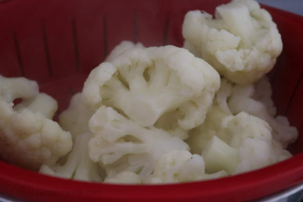 cauliflower florets in colander