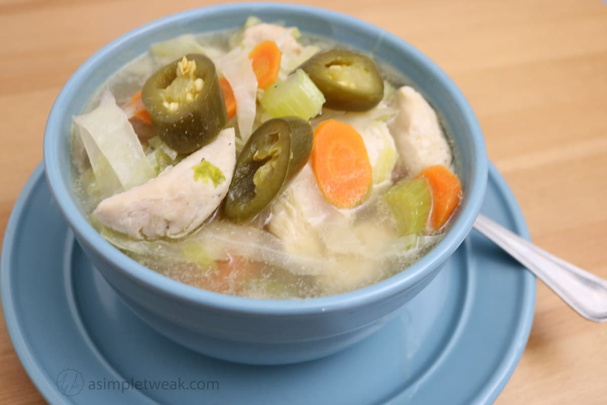 A Bowl Of Chicken, Cabbage, Carrots and Celery Soup