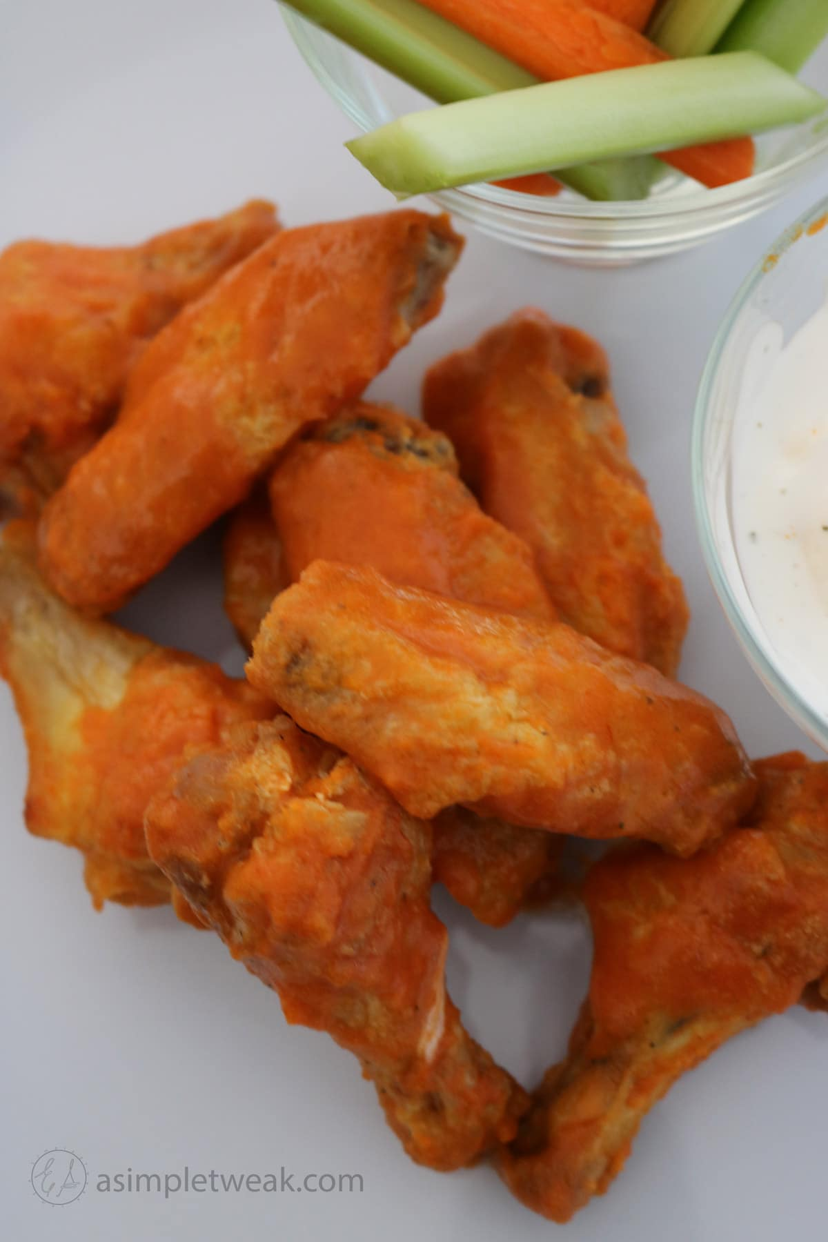 I like to serve the wings with carrots, celery sticks, and Blue cheese or ranch. Grab plenty of napkins and Enjoy!