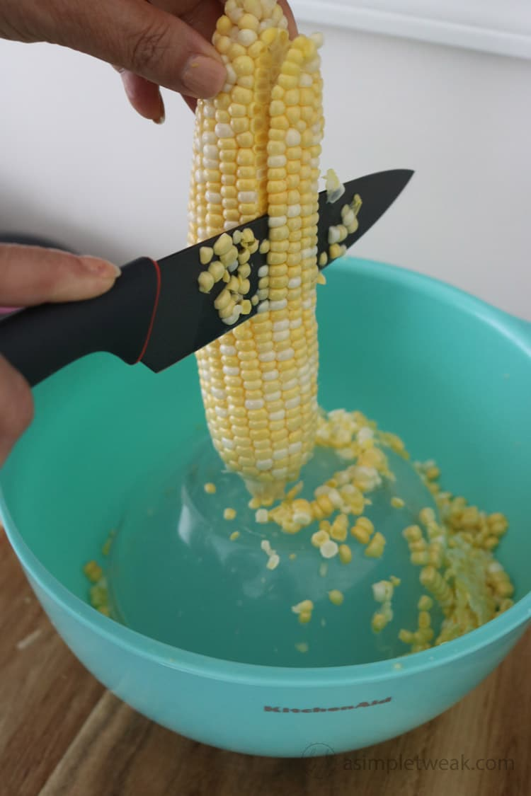 Tip.-In-a-big-bowl-place,-another-bowl-inside-reversed.-This-will-serve-as-a-support-to-keep-the-corn-from-slipping-inside-and-remove-the-kernels-without-making-a-huge-mess