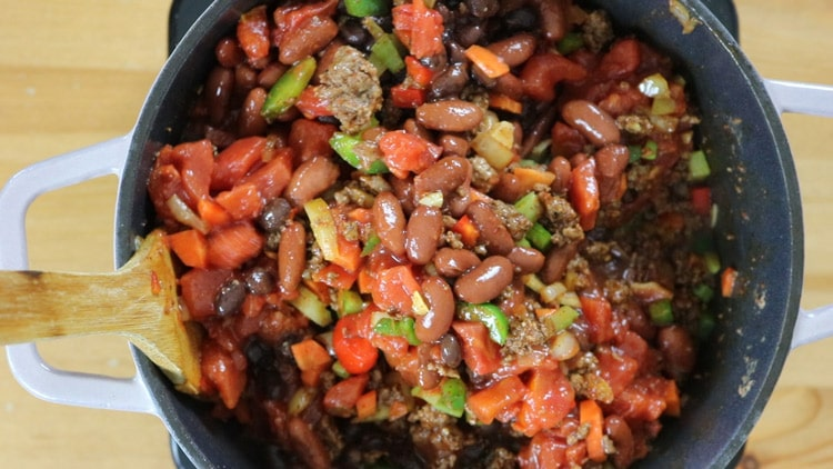 add-the-beans,-tomatoes-and-tomato-paste and stir