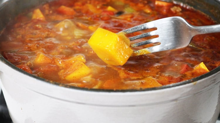 with-a-fork-check-doneness-of-butternut-squash