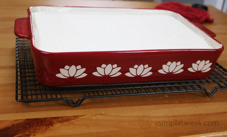 Then using a spatula spread the whipped cream over the top of the cake.